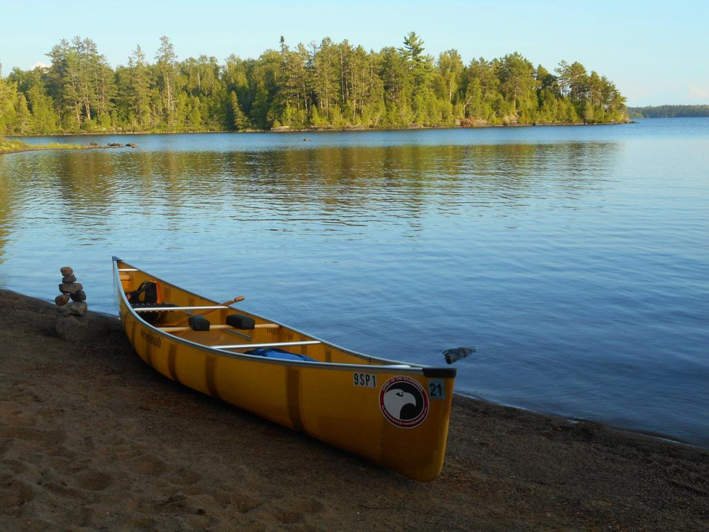 Photo of canoe on lake shore